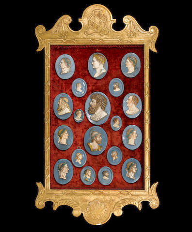 A set of Wedgwood portrait medallions in a giltwood frame one dated 1797