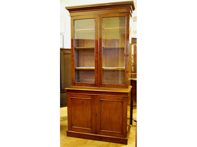A Victorian mahogany bookcase on cupboard