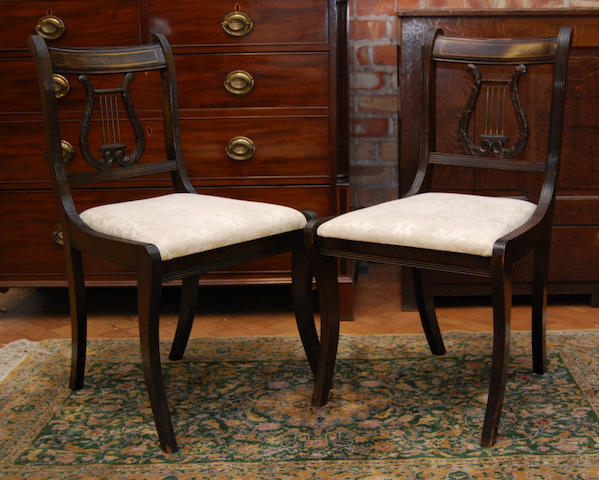 A set of ten Regency-style mahogany and brass strung dining chairs, mid-20th Century