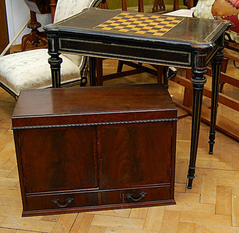 An ebonised fold-over card table, late 19th Century