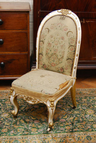 A white-painted and parcel gilt nursing chair, mid-19th Century