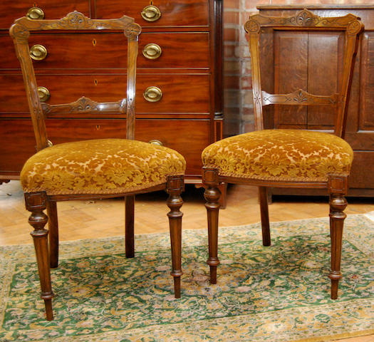 A set of six late Victorian walnut parlour chairs