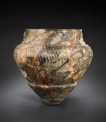 A large Roman breccia cinerary urn