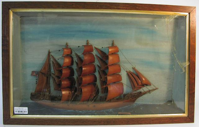 A diorama waterline model of a four masted Barque. 17.5x28x4in (44x71x10cm)