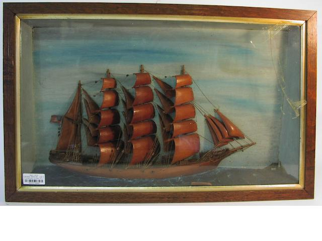 A diorama waterline model of a four masted Barque. 17.5x28x4in(44x71x10cm)