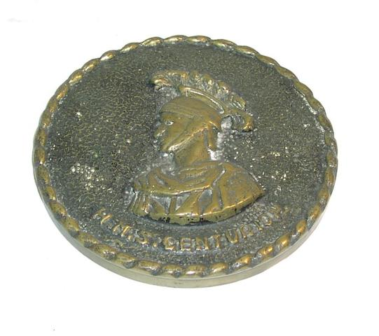 A cast brass tampion, HMS Centurion 6in(15cm)diam.