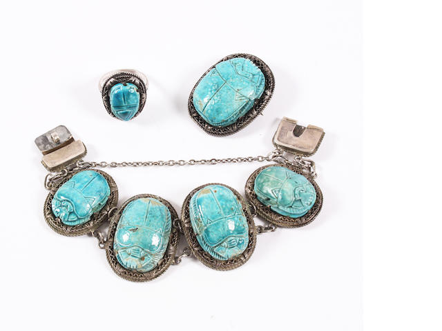 An Egyptian revival faience scarab bracelet, ring and brooch The ring with Egyptian hallmarks for 1906 -1945 period,