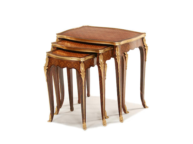 A French early 20th century gilt metal mounted kingwood and marquetry nest of three tables