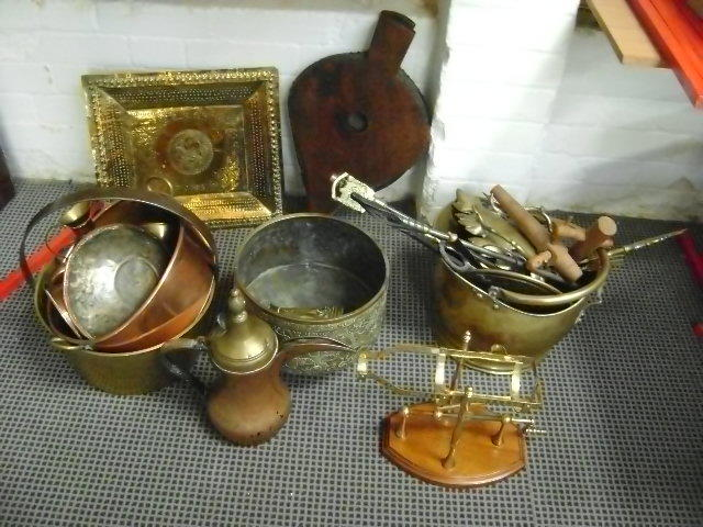 A collection of copper and brass wares