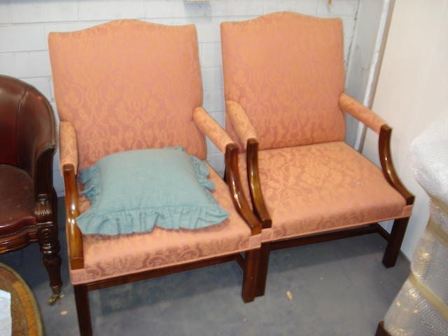 A pair of reproduction mahogany Gainsborough armchairs