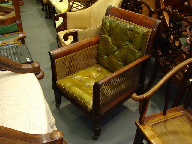 A William IV mahogany bergere with single caned back, sides and seat