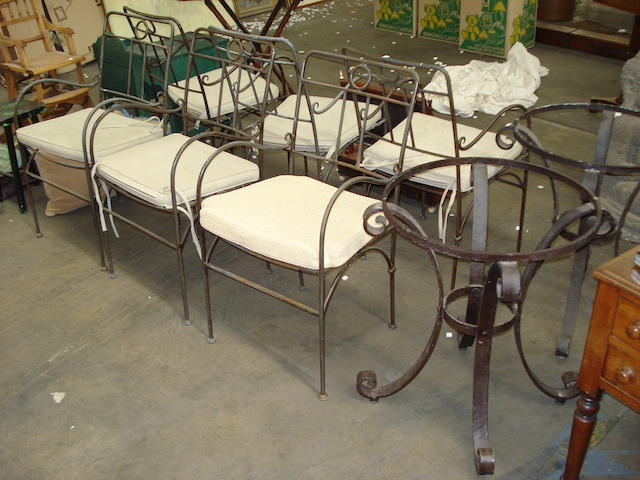 A collection of wrought iron garden furniture including