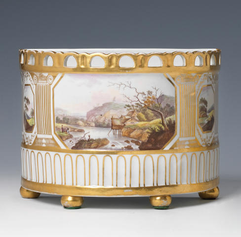 A large W(***) bough pot with pierced rim, panels of landscapes, firing crack to gallery, cover lacking