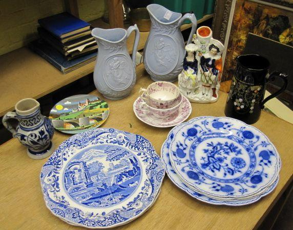 A set of five early 19th Century English pearlware blue and white transfer printed plates, two Copeland Spode Italian sandwich plates, graduated pair of Victorian salt glaze jugs, Staffordshire figure groups, Carlton ware vase, Motto ware two handled vase and various other Victorian and later ceramics.