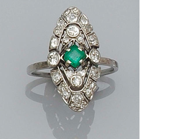 An early 20th century emerald and diamond plaque ring
