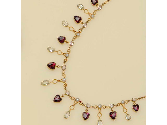 A late Victorian gold mounted almandine garnet and gem set fringe necklace