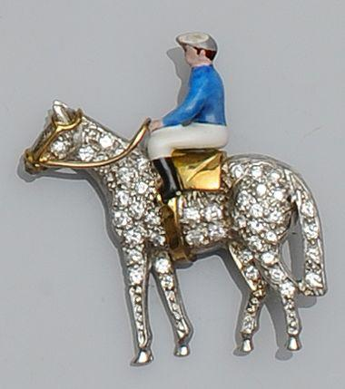 An 18ct gold diamond and enamel horse and jockey brooch