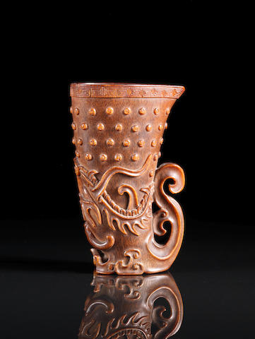 A fine and rare rhyton-form rhinoceros horn libation cup