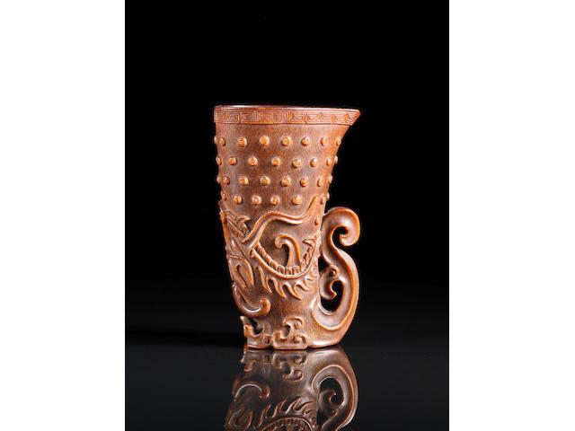 A fine and rare rhyton-form rhinoceros horn libation cup