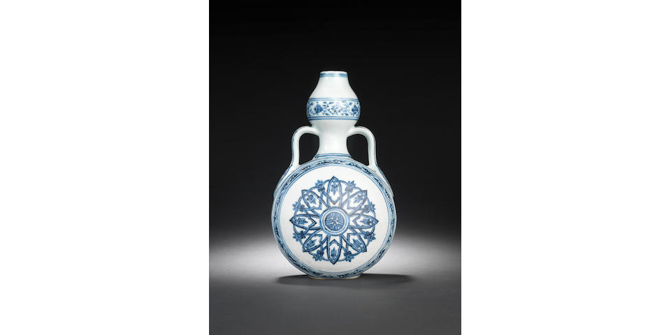 A rare blue and white double gourd moonflask, bianping Early 15th century