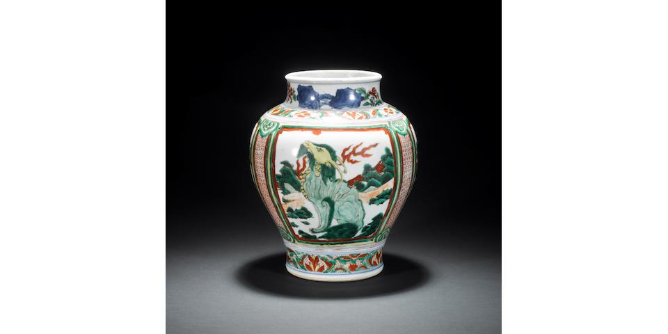 A Transitional Wucai oviform vase with unglazed base 17th century