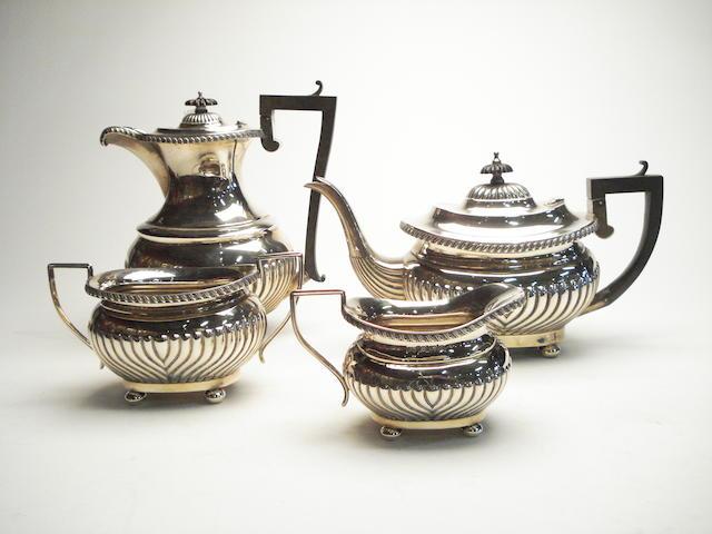 An Edwardian four piece tea and coffee service by Joseph Gloster, Birmingham 1908  (4)