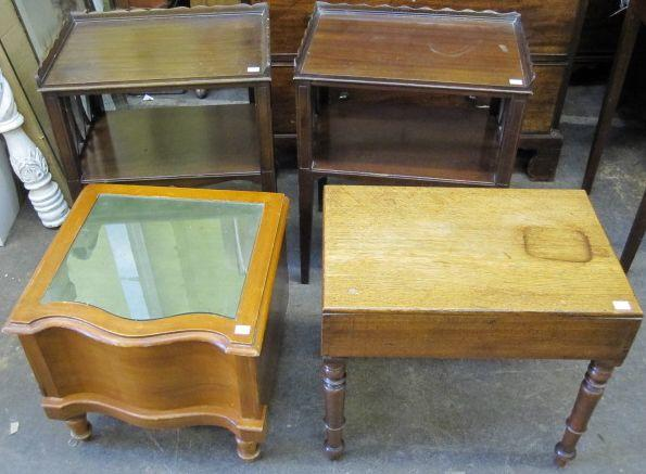 A pair of reproduction mahogany two tier side tables, in early 19th Century style, with fret pierced sides, on tapered legs, 48cm, an early 19th Century oak bidet, the lift-off top enclosing a white ceramic liner, on turned legs and a Victorian satin walnut step commode. (4)