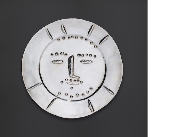 A 'Picasso' silver plate Pablo Picasso (1881-1973)  Dormeur – a repousse silver plate stamped with signature and the silver smith's mark of François and Pierre Hugo and numbered 'Picasso 3/20' (on the reverse)  Diameter: 42.5 cms diameter Conceived in 1956;