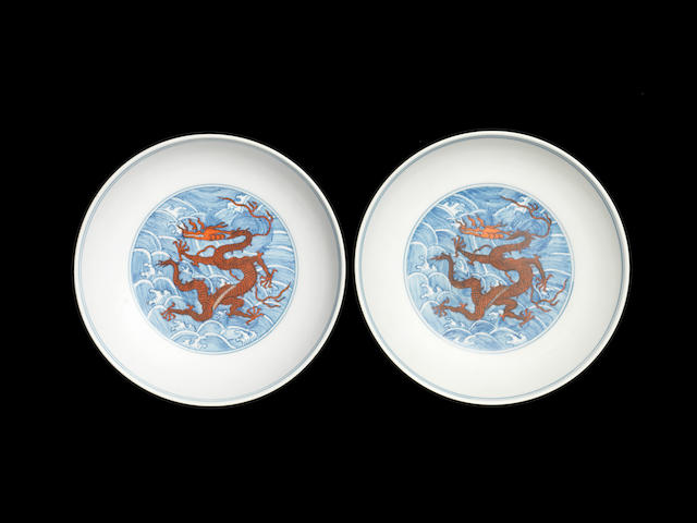 A pair of iron-red-decorated blue and white 'dragon' saucer dishes Qianlong seal marks and of the period