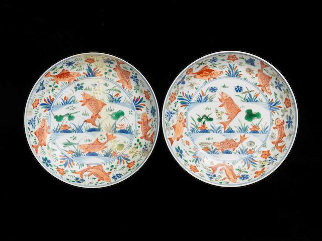 A rare pair of wucai 'fish' dishes Kangxi