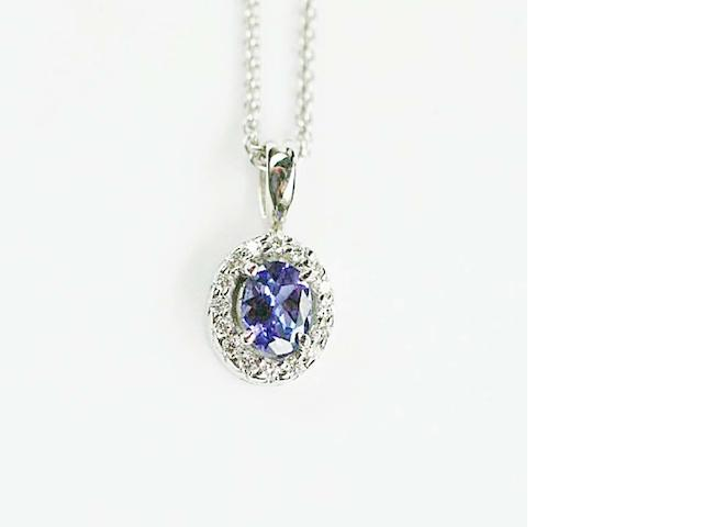An 18ct white gold tanzanite and diamond cluster pendant