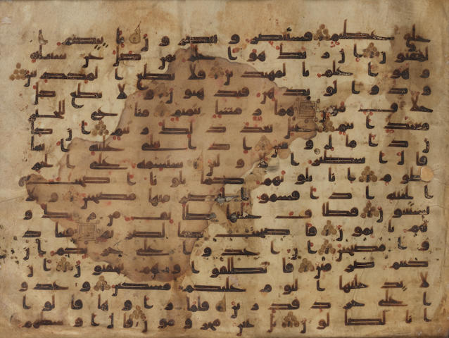 A vellum Qur'an leaf in kufic script (sura LXVII, al-Qalam, The Pen, part of verse 4 and part of verse 28) Abbasid, late 8th/9th Century