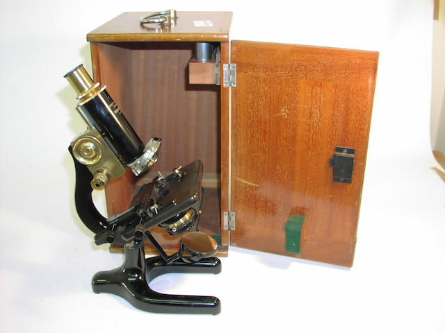 "A Negretti & Zambra ""Rigior IV"" monocular microscope,  English,  1920's,"