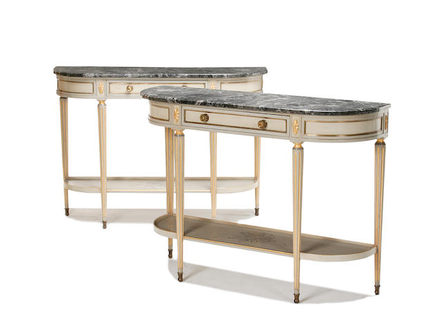 A pair of Louis XVI style painted and parcel gilt console tables
