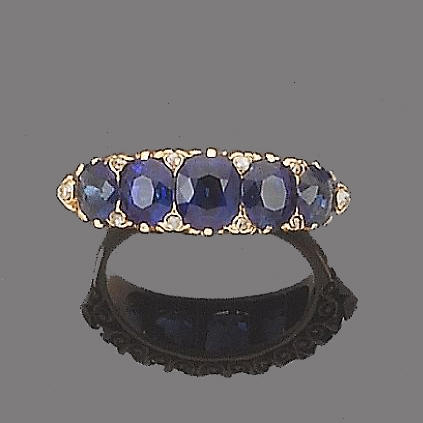 A late 19th century sapphire and diamond five-stone ring