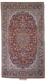 An Isfahan rug Central Persia, 8 ft 1 in x 4 ft 8 in (247 x 143 cm)signature cartouche at one end,  excellent condition