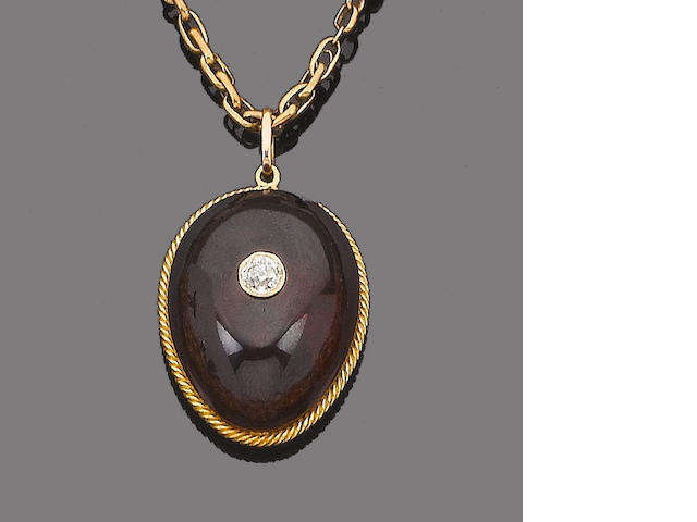 A gold, garnet and diamond pendant necklace