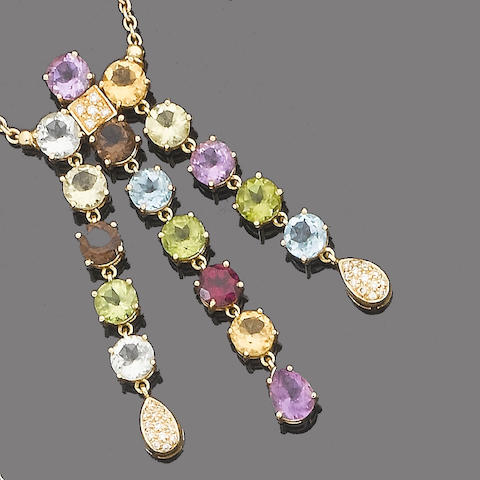 A gem-set pendant necklace and earring suite (2)