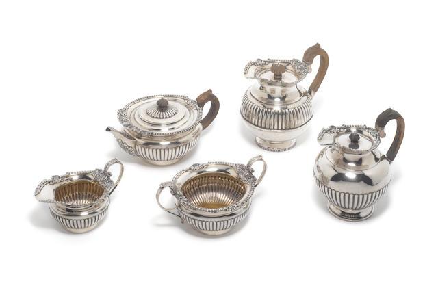 A Victorian silver four-piece tea service, by Walter & John Barnard, London 1894 and a matching hot water pot.  (5)