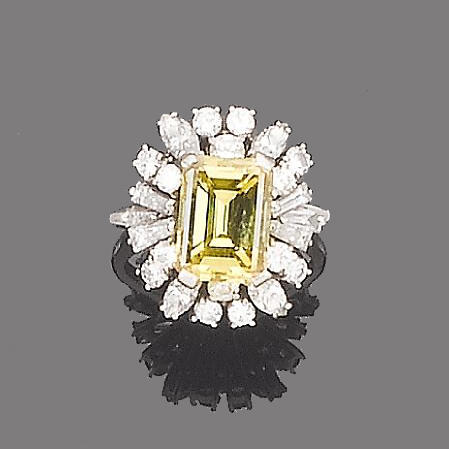 A treated yellow diamond and diamond dress ring