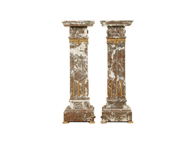 A pair of Louis XVI style Ardennes Grey marble and gilt metal mounted pedestals