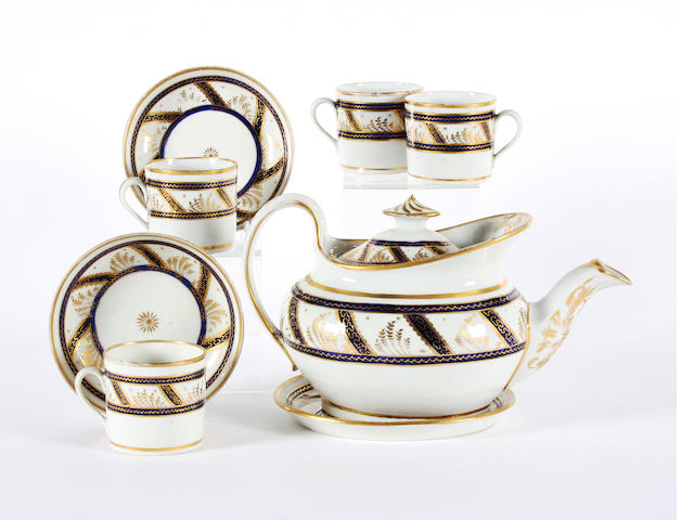 A Newhall teapot, cover and stand, four cups and two saucers Circa 1795.