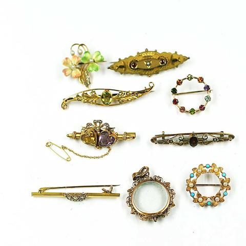 A collection of eight brooches and a locket (9)