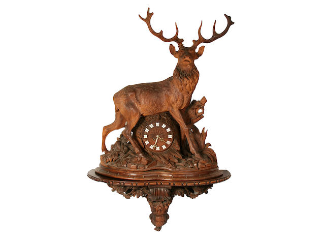 A large late 19th century Black Forest carved wood clock modelled as a stag