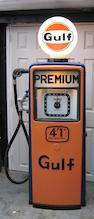 An Avery Hardoll clock faced petrol pump,