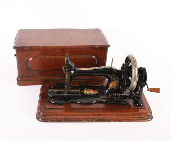 Bradbury sewing machine in walnut case