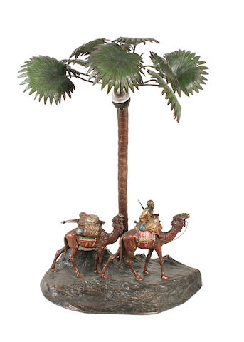 Manner of Franz Bergman (Austrian, 1861-1936): An early 20th century cold painted bronze figural lamp base depicting an Arab with two camels