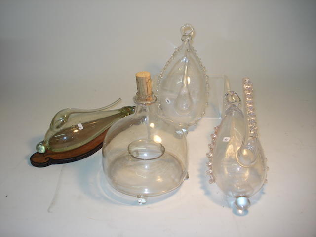 Three weather glasses and a glass wasp trap, 19th century,  (4)