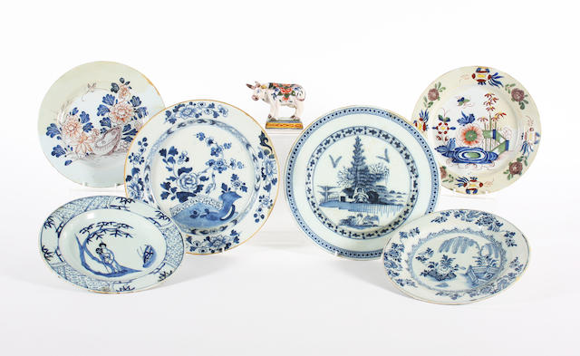 Two English delft polychrome plates, four delft blue and white plates and a polychrome model of a cow 18th and 19th Century.