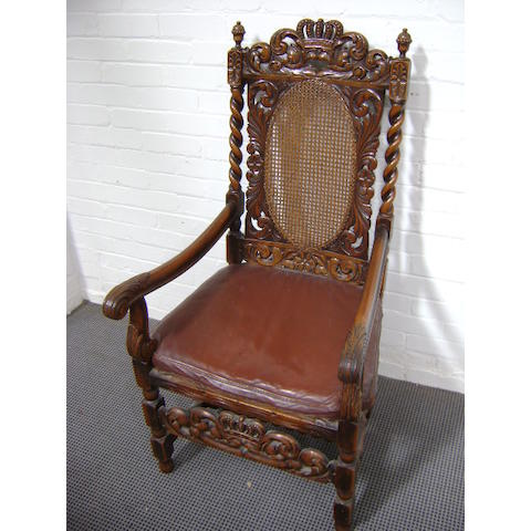A set of seven Charles II style walnut dining chairs,